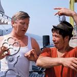 Two pilgrims joke on the Danube