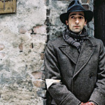 The Pianist hides in a devastated Warsaw