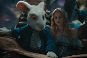 A well-dressed rabbit shows Alice the Oraculum