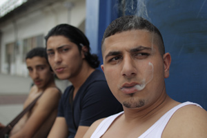 Young men kill time with marijuana and machismo