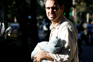 Ibrahim's infant son helps with the begging