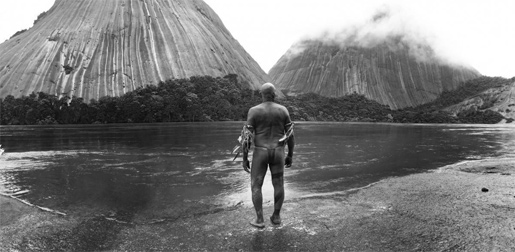 A shaman shows two white visitors the Embrace of the Serpent